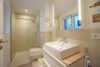Traumhafte Neubauwohnung mit Terrasse und Garten - Badezimmer 2