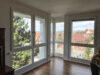 Helle und großzügige 4,5-Zimmer Wohnung mit 3 Terrassen und tollem Blick - Wohnzimmer