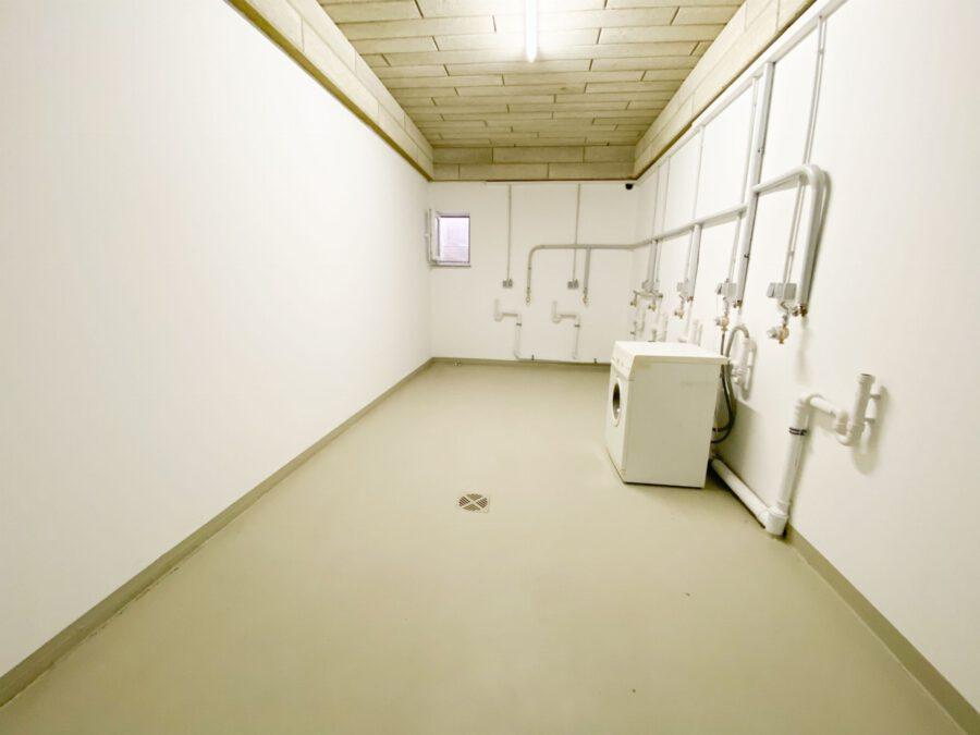 Erstbezug! Hochwertiges Apartment mit Terrasse und Küche - Waschküche